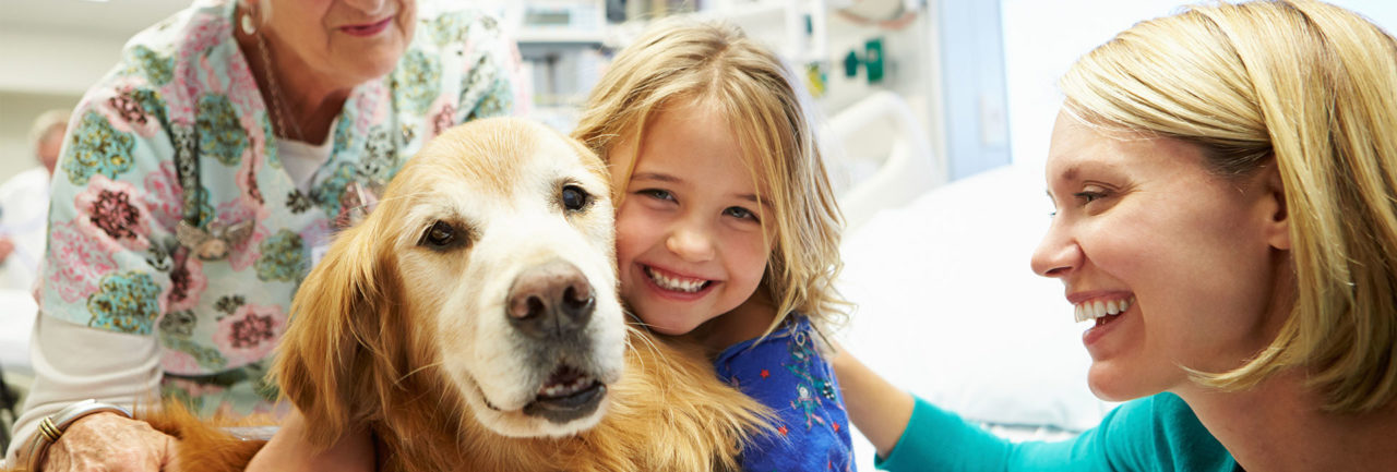 Family with Golden Retriever at Pet Doctor