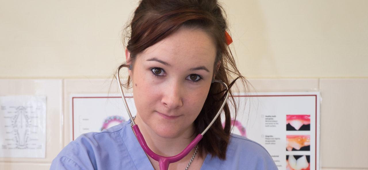 vet nurse listening to dog heart beat in Adelaide